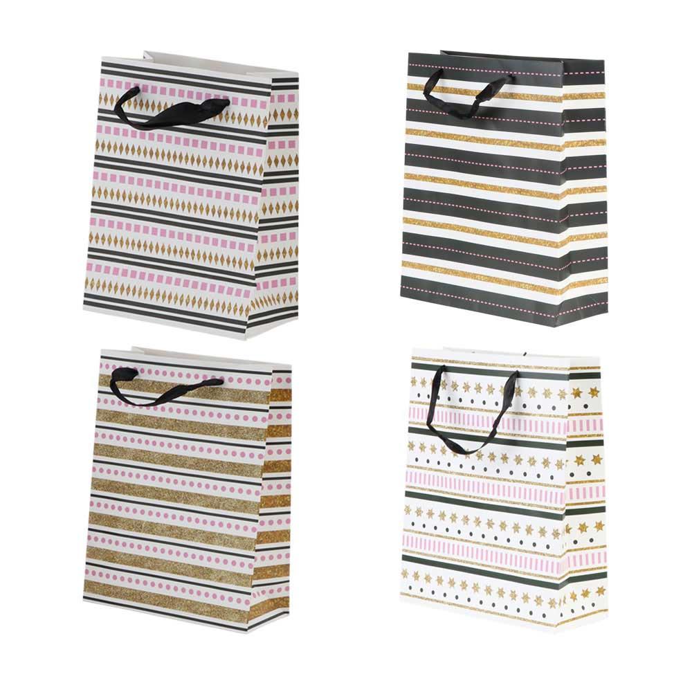Small Geometric shapes gift bag with satin ribbon متجر 15 وأقل