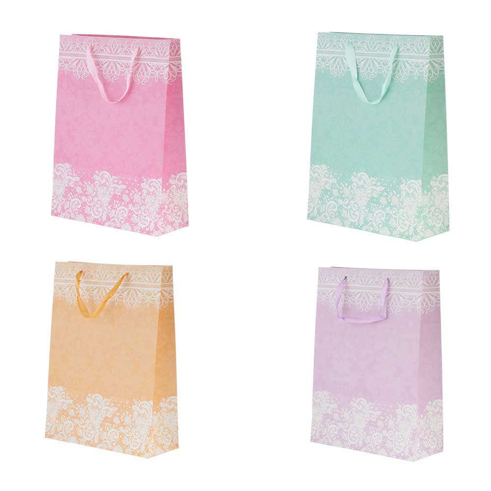 Large decorated gift bag with satin ribbon متجر 15 وأقل