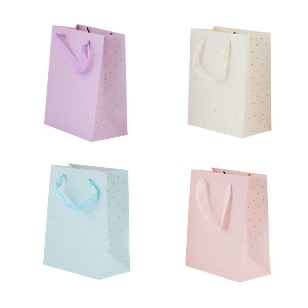 Small dotted gift bag with satin ribbon متجر 15 وأقل