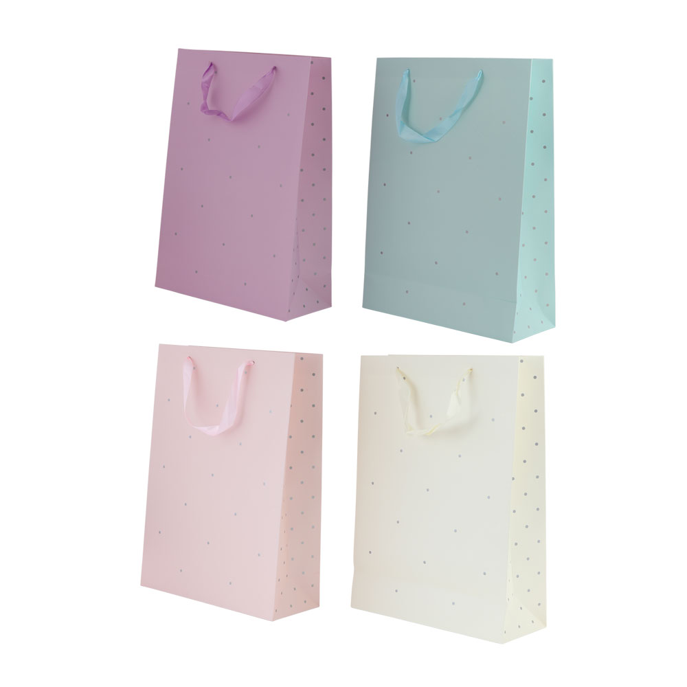 Large dotted gift bag with satin ribbon متجر 15 وأقل