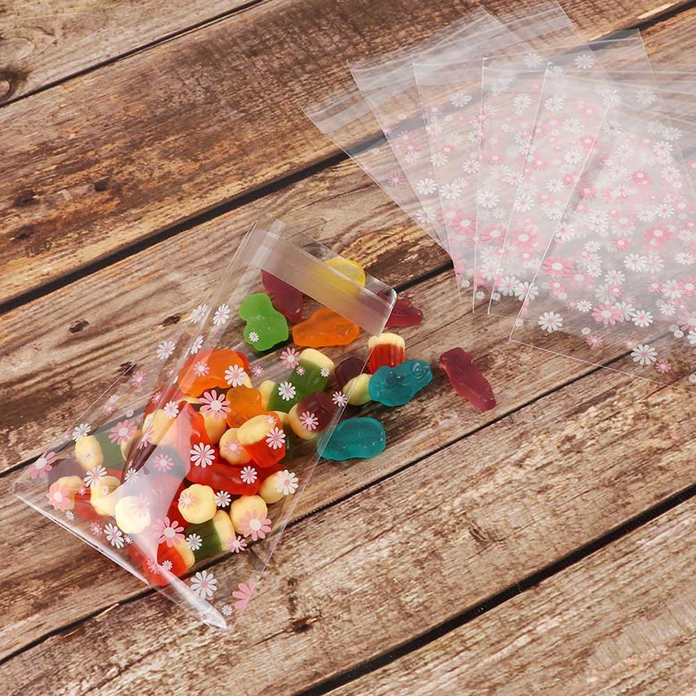أكياس تغليف لاصقة 10×10سم شفافة برسمة زهور بيضاء ووردي 10 قطع متجر 15 وأقل