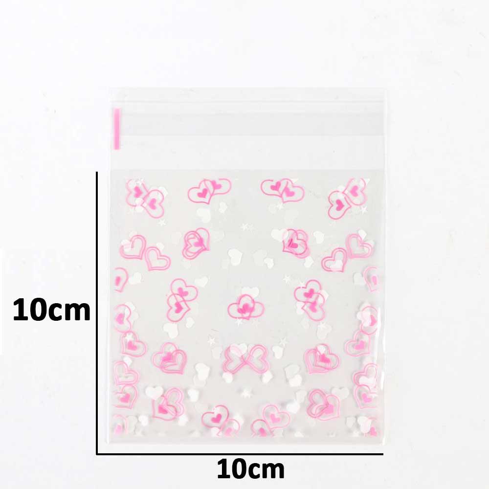 أكياس تغليف لاصقة 10×10سم شفافة برسمة قلوب بيضاء ووردي 10 قطع متجر 15 وأقل