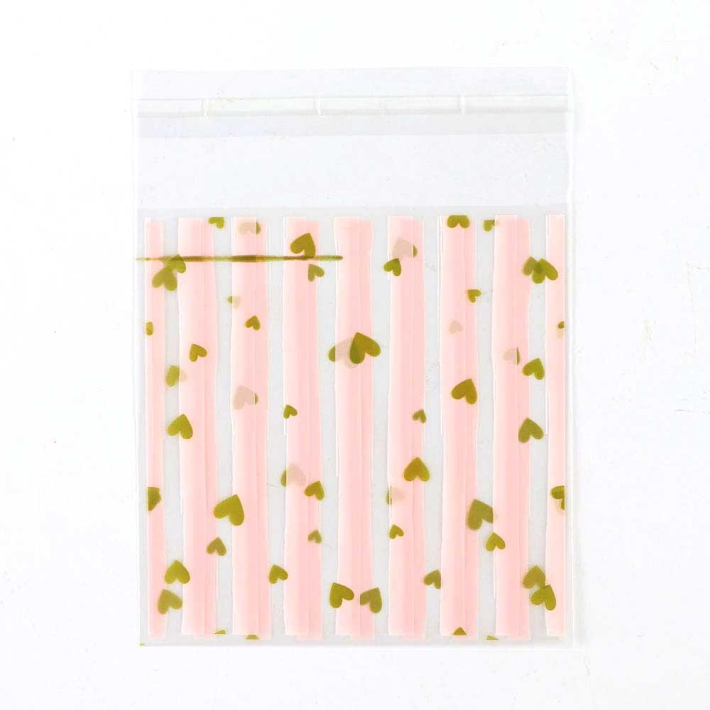 أكياس تغليف لاصقة 10×10سم شفافة مقلمة وردي مع قلوب ذهبية 10 قطع متجر 15 وأقل