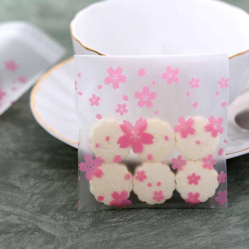 أكياس تغليف نايلون بلاصق للغلق شفافة بطبعات أزهار وردية 10 قطع متجر 15 وأقل