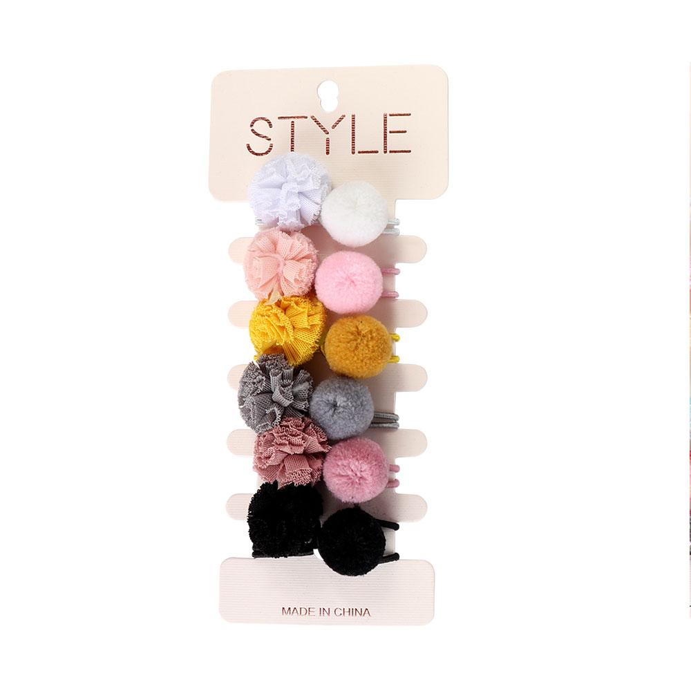 طقم ربطات شعر مزينة بكرات من الفرو الملونة 6 حبات ألوان مختلفة متجر 15 وأقل