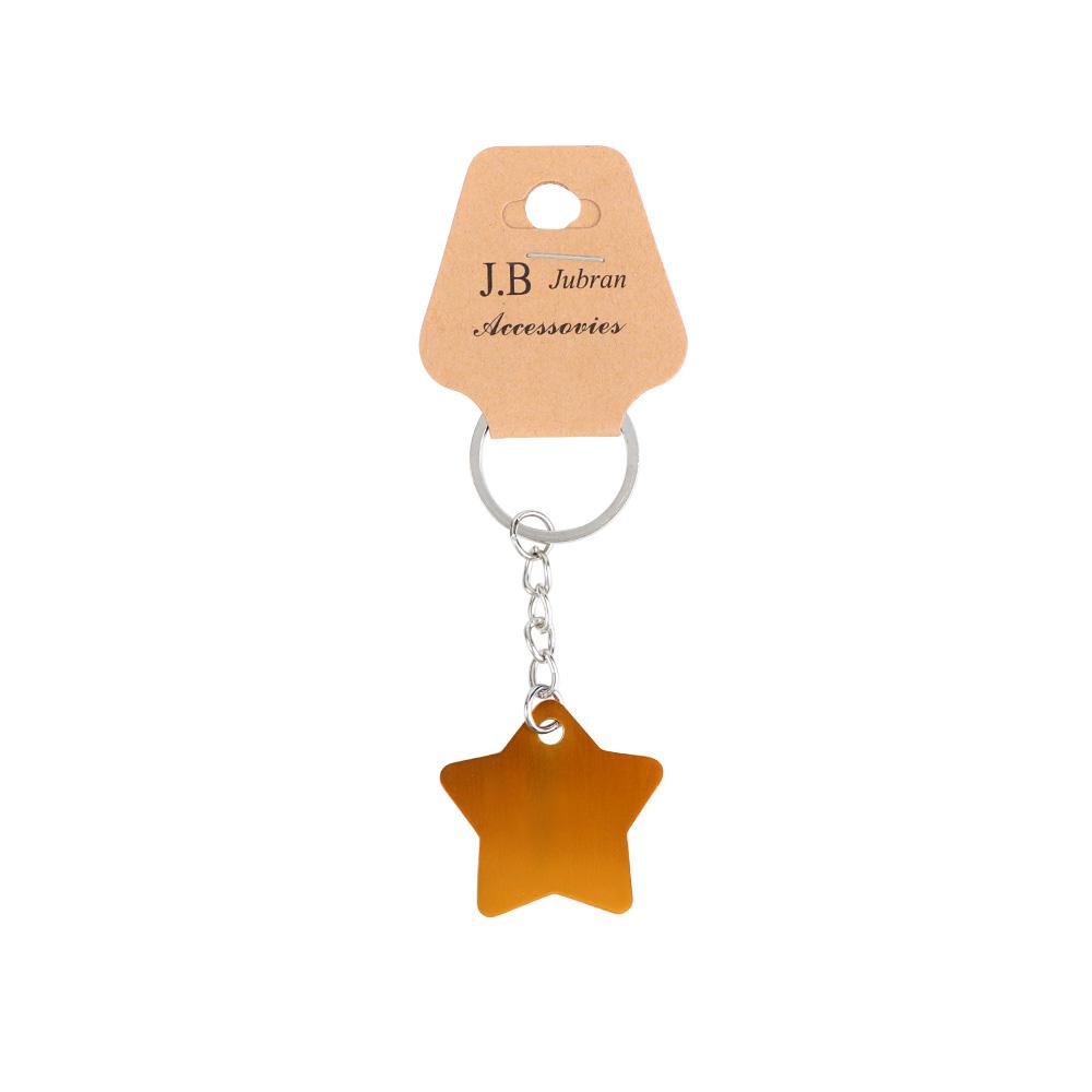 ميدالية مفاتيح على شكل نجمة لون أصفر متجر 15 وأقل