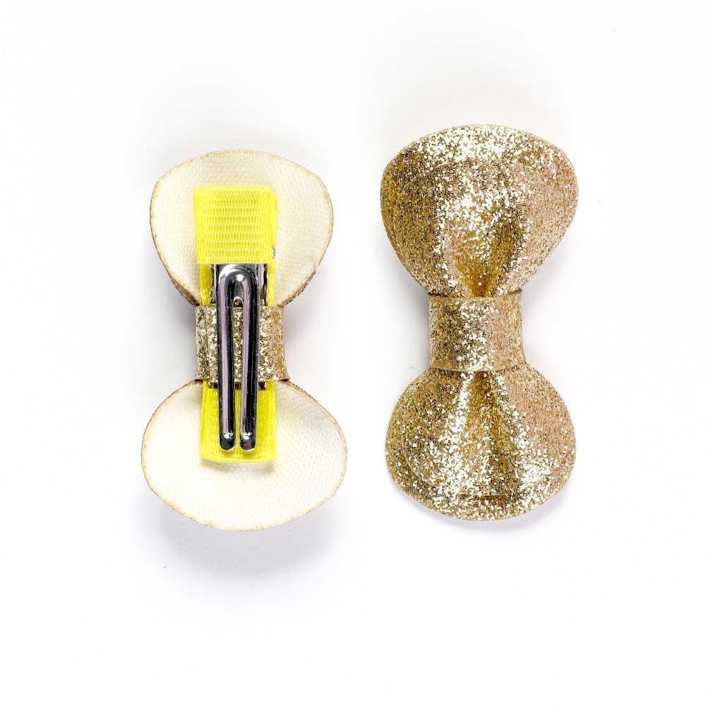 قطعتان من مشابك الشعر بتصميم فيونكة لون ذهبي متجر 15 وأقل