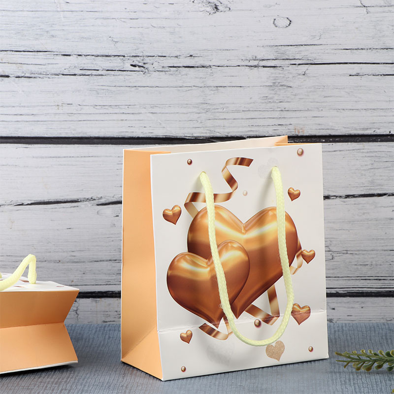 A Small Yellow Gift Bags With Golden hearts design متجر 15 وأقل