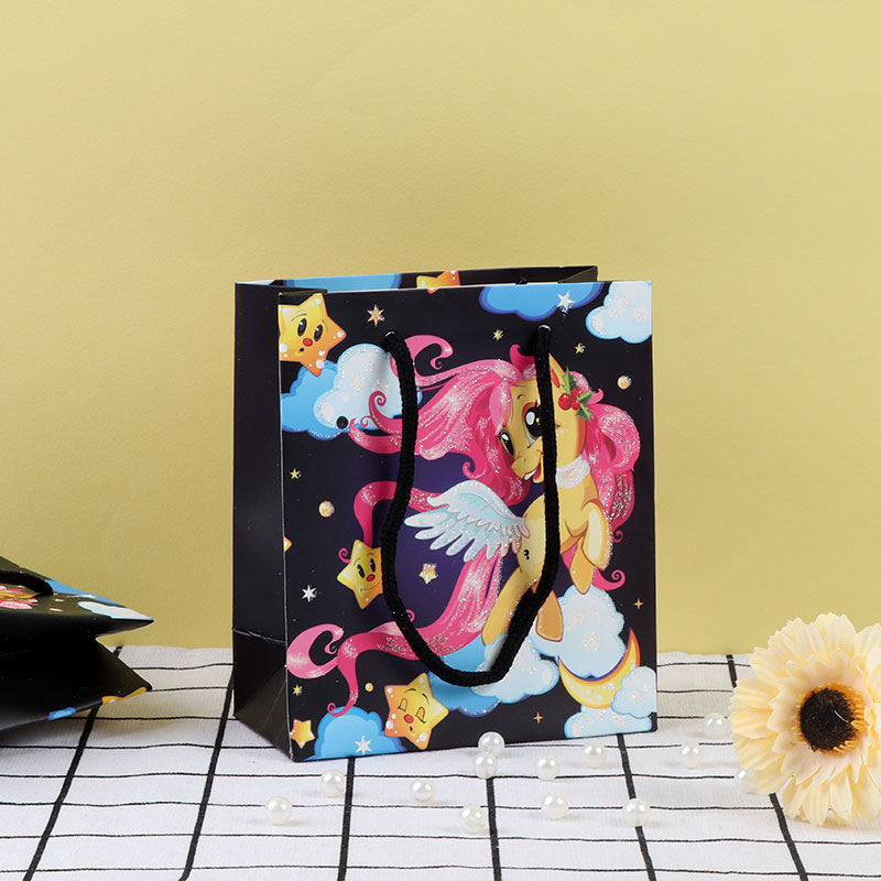 A Small Black Gift Bags With Cartoons Stickers متجر 15 وأقل