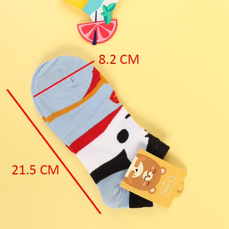 A pair of stretchy socks with a cartoon print متجر 15 وأقل